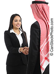 Arab saudi business man and woman handshaking isolated on a...