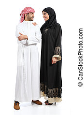 Full body of an arab saudi couple posing together isolated...