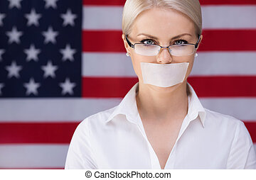 Freedom of speech - Young girl with her ??mouth sealed over...