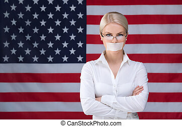 Silence - Young girl with her mouth sealed over American...