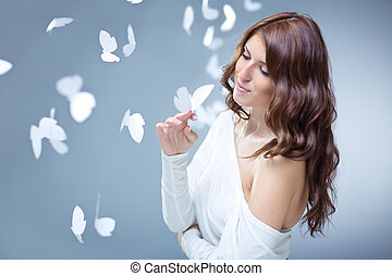 Ease - Beautiful girl with butterflies in studio