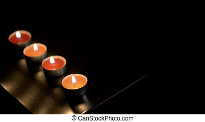 Candles in the dark glowing vibrantly