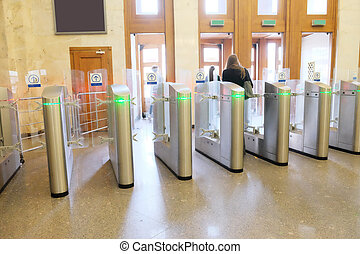 turnstile at a railway vestibule - The image of turnstile at...