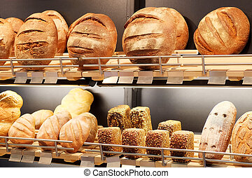 an Assorted kinds of fresh baked bread - the image of an...