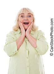 What a surprise Happy senior woman holding head in hands and...
