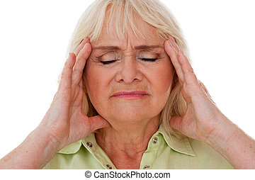 Feeling awful headache. Depressed senior woman holding head in hands and keeping eyes closed while standing isolated on white background
