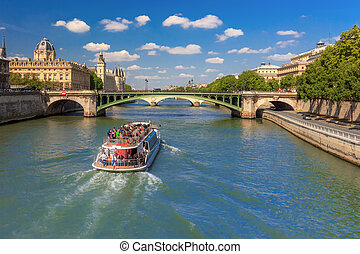 River Seine and the Conciergerie in Paris, France - The...