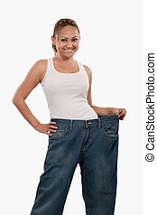 Woman in big pants - Attractive slim Asian woman smiling...