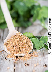 Coriander Powder on a wooden spoon - Small Portion of...