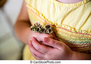 Child holding flowers