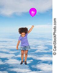 African little girl flying on the sky