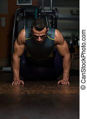 Pushups Upper Position - Young Athlete Doing Pushups As Part...