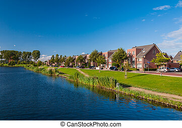 Peaceful quiet suburban with expensive houses on lake in Europe
