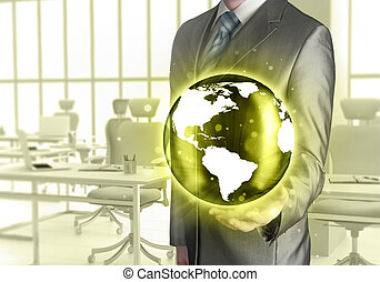 Businessman holds Earth in a hand