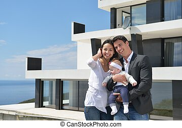 happy young family at home - happy young family couple with...
