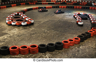 Indoor karting - Safety berriers made of old wheels in...