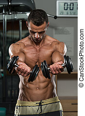 Young Man Doing Exercise For Chest - Young Man Working Out...