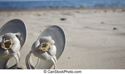 Flip-flops shoes on beach Summer - Beige female flip-flops...