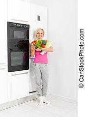 woman raw fresh vegetables refrigerator - young woman hold...