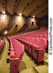 Cinema interior - Pink row 7 of empty cinema auditorium with...