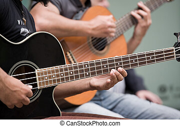 Guitar players - Street guitarists. Musicians are playing on...