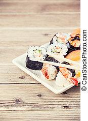Maki Sushi set on wooden background