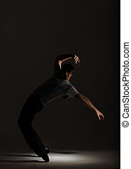 Tap Dancer - Young male tap dancer on his toes in the...