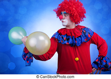 Clown with balloons in hand on blue background