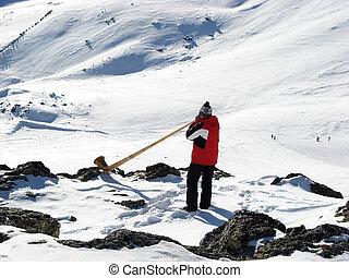 Man playing alp horn