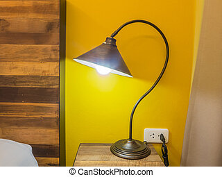 Table lamp in the bedroom at night