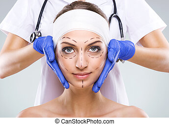 Plastic surgery - Beautiful woman face, with surgical...