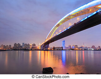 shanghai lupu bridge across the huangpu river at night