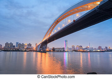 lupu bridge in nightfall ,across the huangpu river in...