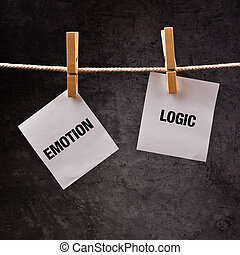 Emotion or Logic concept. Words printed on note paper and...