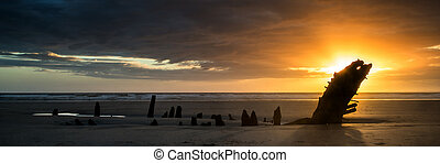 Landscape panorama ship wreck on Rhosilli Bay beach in Wales...