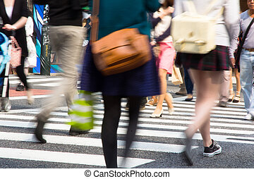 Crowds of people crossing the center of Shibuya, Tokyo Japan