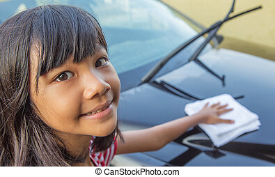 Washing Car - Young Asian Malay girl washing car