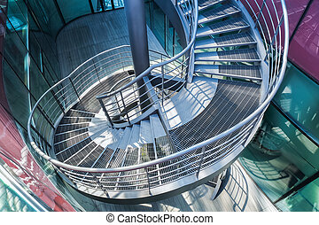 spiral stair - metal spiral staircase in modern building...