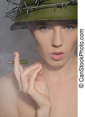 Female soldier in helmet with bullet-cigarette - Female...