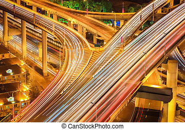flyover closeup at night - busy traffic light trails on the...