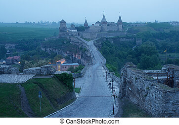 View of the old fortress in predawn - Road leading to the...