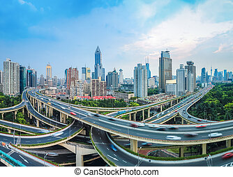 city elevated road junction at dusk - panoramic view of city...