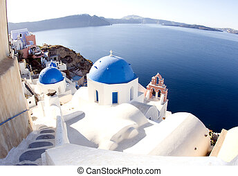 santorini greek island scene with blue dome churches - blue...