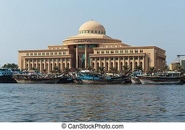 Sharjah port - SHARJAH, UAE - OCTOBER 29: Sharjah - port, on...