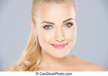 Beautiful blond woman with a serene smile