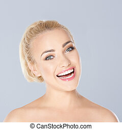 Happy blond woman with a beaming toothy smile - Happy young...