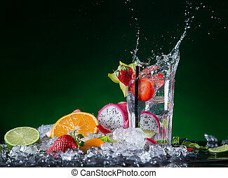 Fresh fruit cocktail in freeze motion splashing, close-up