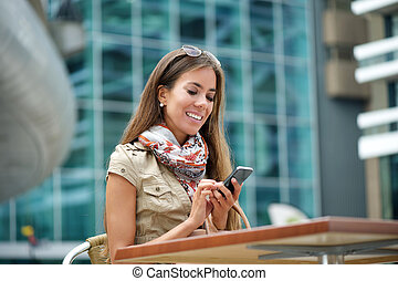 Young woman sending text message - Portrait of a young woman...