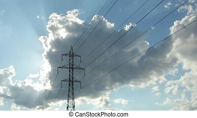 Pylon against blue sky with white clouds