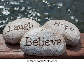 Laugh, hope, Believe stones - three stones written with the...